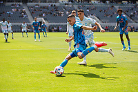 LOS ANGELES, CA - MAY 29: Jesús Medina #19 of NYCFC sends ball into the box during a game between New York City FC and Los Angeles FC at Banc of California Stadium on May 29, 2021 in Los Angeles, California.