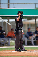 Umpire Zee Zdenek calls a strike during a Gulf Coast League game between the GCL Astros and GCL Marlins on August 8, 2019 at the Roger Dean Chevrolet Stadium Complex in Jupiter, Florida.  GCL Marlins defeated GCL Astros 5-4.  (Mike Janes/Four Seam Images)
