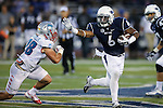 Nevada's Don Jackson runs against New Mexico's Jake Rothschiller during the second half of an NCAA college football game in Reno, Nev., on Saturday, Oct. 10, 2015. Nevada won 35-17.(AP Photo/Cathleen Allison)