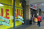 Sports Direct shop, sale, a  high street shop going out of business. Stains Middlesex UK.