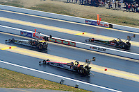 Apr. 14, 2012; Concord, NC, USA: NHRA top fuel dragster drivers (top to bottom) Terry McMillen , Bob Vandergriff Jr and Dom Lagana race during qualifying for the Four Wide Nationals at zMax Dragway. Mandatory Credit: Mark J. Rebilas-