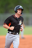 Miami Marlins infielder Justin Bohn (94) during a minor league spring training game against the New York Mets on March 28, 2014 at the Roger Dean Stadium Complex in Jupiter, Florida.  (Mike Janes/Four Seam Images)
