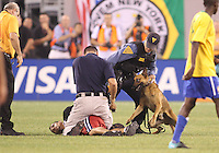 Got you. Field intruder is caught at the end of an international friendly match between the USA and Brazil in Giants Stadium, on August 10 2010, in East Rutherford, New Jersey.Brazil won 2-0.