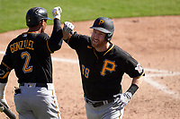 Pittsburgh Pirates Todd Frazier (99) celebrates with Erik González (2) after hitting a home run during a Major League Spring Training game against the Baltimore Orioles on February 28, 2021 at Ed Smith Stadium in Sarasota, Florida.  (Mike Janes/Four Seam Images)