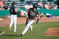 Nick Schnell (7) of the Charleston Boiled Peanuts hustles towards home plate against the Augusta GreenJackets at Joseph P. Riley, Jr. Park on June 26, 2021 in Charleston, South Carolina. (Brian Westerholt/Four Seam Images)