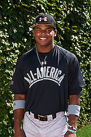 Outfielder Stone Garrett (22) of George Ranch High School in Sugar Land, Texas poses for a photo before the Under Armour All-American Game on August 24, 2013 at Wrigley Field in Chicago, Illinois.  (Mike Janes/Four Seam Images)
