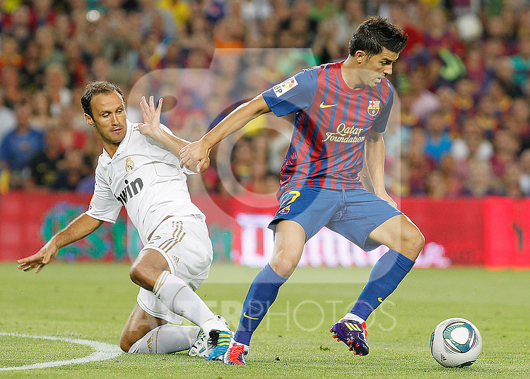 FC Barcelona's David Villa (r) and Real Madrid's Ricardo Carvalho during Spanish Supercup 2nd match.August 17,2011. (ALTERPHOTOS/Acero)