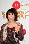 """Dec. 29, 2009 - Enka singer, Kaori Mizumori, poses for photographers during the first day of rehearsals for 'Kohaku Uta Gassen,' or also more commonly known as 'Kohaku.' Produced by the Japanese public broadcaster, NHK, this annual music show airs on New Year's Eve and ends shortly before midnight, where everyone on air pauses to say """"Happy New Year."""" The 'Red and White Song Battle' separates the most popular music artists during each given year into teams of red and white: the red team consists of all female artists and the white team is all male artists. For an artist to perform on Kohaku, it is a great honor as only the most successful enka singers and J-Pop artist are strictly invited to perform by invitation only. Today, for a J-Pop artist or enka singer to perform on Kohaku, is most notably recognized to be a big highlight in a singer's career due to the show's large reach of audience during New Year's Eve."""