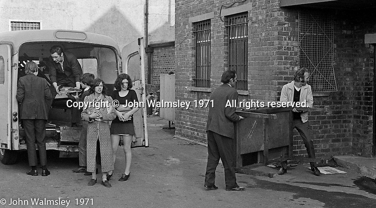 Bill Murphy, white jacket.  Moving equipment and books into the building, Scotland Road Free School, Liverpool  1971.  Also known as the Scotland Road or Scottie Road Free School it was founded and run by two teachers, John Ord and Bill Murphy (if I've got these names wrong, please tell me!) who worked with truanting kids and provided somewhere to go and things to do.  They begged and borrowed an old building, desks, books and an old ambulance for trips.