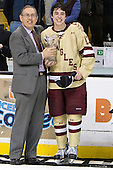 Steve Nazro and Johnny Gaudreau (BC - 13) pose for the cameras after Gaudreau was awarded MVP of the 2012 Beanpot. - The Boston College Eagles defeated the Boston University Terriers 3-2 (OT) to win the 2012 Beanpot championship on Monday, February 13, 2012, at TD Garden in Boston, Massachusetts.