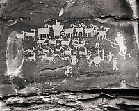 The Great Hunt panel is very well known petroglyph in Nine Mile Canyon.  Many people have refered to this panel as a fine example of the Fremont culture art.  The details chiseled in the rockface, stand out vividly do to the reflected light from the oppisite canyon wall.