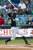 Omaha Storm Chasers outfielder Paulo Orlando #16 swings the bat against the Round Rock Express in the Pacific Coast League baseball game on April 4, 2013 at the Dell Diamond in Round Rock, Texas. Round Rock defeated Omaha in their season opener 3-1. (Andrew Woolley/Four Seam Images).