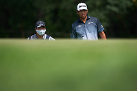 29th August 2020, Olympia Fields, Illinois, USA;  Hideki Matsuyama of Japan talks with caddie Shota Hayafuji before putting the ball on the 10th green during the third round of the BMW Championship on the North Course at Olympia Fields Country Club