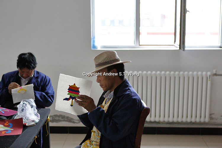 Nangqen County, Yushu Tibetan Autonomous Prefecture, Qinghai Province, China - Tibetan men do embroidery, August 2019.