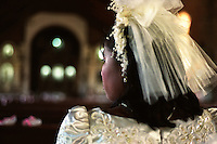 A bride waits for the wedding ceremony to start in Sarrat, Ilocos Norte, a province in the northern tip of the Philippines. With very few opportunities, women in small rural towns like Sarrat marry young, with family rearing becoming their career of sorts. 28 November 1998