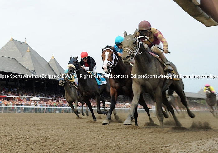 Hot Summer  (no. 6), ridden by Cornelio Velasquez and trained by Davis Fawkes, wins the 9th running of the grade 3 Victory Ride Stakes for three year old fillies on August 27, 2011 at Saratoga Race Track in Saratoga Springs, New York.  (Bob Mayberger/Eclipse Sportswire)