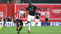 Bryan Mbeumo of Brentford and Charlton's Naby Sarr challenge for the ball during Brentford vs Charlton Athletic, Sky Bet EFL Championship Football at Griffin Park on 7th July 2020