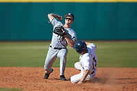 Jordan Bowersox (13) of the Penn State Nittany Lions slides into second base while Sam Flamini (14) of the Xavier Musketeers makes a throw to first base at Coleman Field at the USA Baseball National Training Center on February 25, 2017 in Cary, North Carolina. The Musketeers defeated the Nittany Lions 10-4 in game one of a double header. (Brian Westerholt/Four Seam Images)