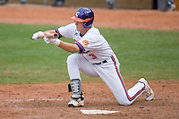 Jeff Schaus #3 of the Clemson Tigers lays down a bunt versus the North Carolina Tar Heels at Durham Bulls Athletic Park May 23, 2009 in Durham, North Carolina. The Tigers defeated the Tar Heals 4-3 in 11 innings.  (Photo by Brian Westerholt / Four Seam Images)