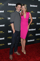 WEST HOLLYWOOD, CA, USA - AUGUST 23: Christopher Backus, Mira Sorvino arrives at the 2014 Entertainment Weekly Pre-Emmy Party held at the Fig & Olive on August 23, 2014 in West Hollywood, California, United States. (Photo by Xavier Collin/Celebrity Monitor)