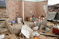 Two children play in the remains of their home, destroyed in the tsunami which struck South Asia on 26/12/2004. An underwater earthquake measuring 9 on the Richter scale triggered a series of tidal waves which caused devastation when they struck dry land. 12 countries were affected by the tsunami, with a combined death toll of over 150,000. © Fredrik Naumann