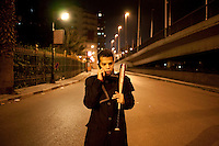 A young man guards the neighbourhood of Zamalek from looters and gangs as he talks on a mobile phone holding a baseball bat. Continued anti-government protests take place in Cairo calling for President Mubarak to stand down. After dissolving the government, Mubarak still refuses to step down from power.