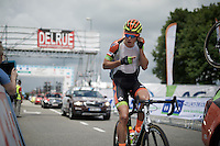 Wout Van Aert (BEL/Crelan-Vastgoedservice) getting a new radio mid-race<br /> <br /> Belgian National Road Cycling Championships 2016<br /> Les Lacs de l'Eau d'Heure