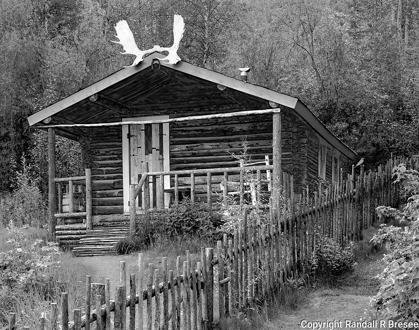 """""""Yukon Cabin of the Writer Robert Service"""" <br /> Dawson City, Yukon Territory, Canada <br /> <br /> Robert W. Service was a prolific writer who enjoyed great popularity as a poet and novelist. Some of his best known work retold stories of Yukon life during the early gold rush years including """"The Shooting of Dan McGrew"""", """"The Cremation of Sam McGee"""" and """"The Call of the Wild."""" This photo shows the two-room cabin where Service lived in Dawson."""
