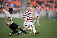 Houston, TX -  Sunday, December 11, 2016: Logan Gdula (17) of the Wake Forest Demon Deacons clears the ball in front of Derek Waldeck (29) of the Stanford Cardinal at the  NCAA Men's Soccer Finals at BBVA Compass Stadium.