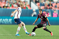 DENVER, CO - JUNE 6: Tim Ream #13 of the United States moves with the ball during a game between Mexico and USMNT at Mile High on June 6, 2021 in Denver, Colorado.