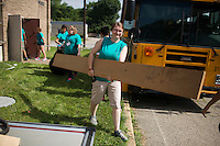 """Members remove trash during """"Circle the City with Service,"""" the Kiwanis Circle K International's 2015 Large Scale Service Project, on Wednesday, June 24, 2015, at the Friendship Westside Center for Excellence in Indianapolis. (Photo by James Brosher)"""