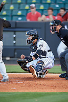 Jackson Generals catcher Oscar Hernandez (28) waits to receive a pitch waits to receive a pitch in front of home plate umpire Brock Ballou during a game against the Chattanooga Lookouts on April 27, 2017 at The Ballpark at Jackson in Jackson, Tennessee.  Chattanooga defeated Jackson 5-4.  (Mike Janes/Four Seam Images)