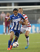 Stuart Holden #11 of the USMNT battles against Andy Najar #14 of Honduras during the match on July 24, 2013 at Dallas Cowboys Stadium in Arlington, TX.
