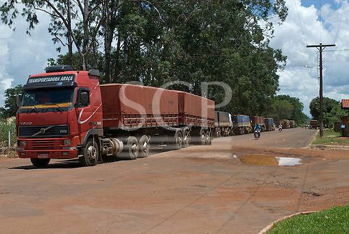 Canarana, Mato Grosso State, Brazil. Soya lorries passing through the town.