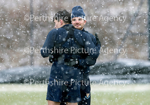 St Johnstone Training…22.01.19   McDiarmid Park<br />Matty Kennedy gives a hug to team mate Aaron Comrie during a snowy training session this morning ahead of tomorrw night's game against Livingston.<br />Picture by Graeme Hart.<br />Copyright Perthshire Picture Agency<br />Tel: 01738 623350  Mobile: 07990 594431