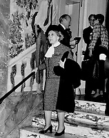 Estee Lauder pauses on the marble steps of the Hotel Pierre where Bill Blass showed his spring line.