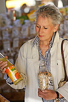 Older female person on weekly market