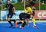 NZ's Hugo Inglis tries to tackle Australia's Blake Govers during the Sentinel Homes Trans Tasman Series hockey match between the New Zealand Black Sticks Men and the Australian Kookaburras at Massey University Hockey Turf in Palmerston North, New Zealand on Sunday, 30 May 2021. Photo: Dave Lintott / lintottphoto.co.nz
