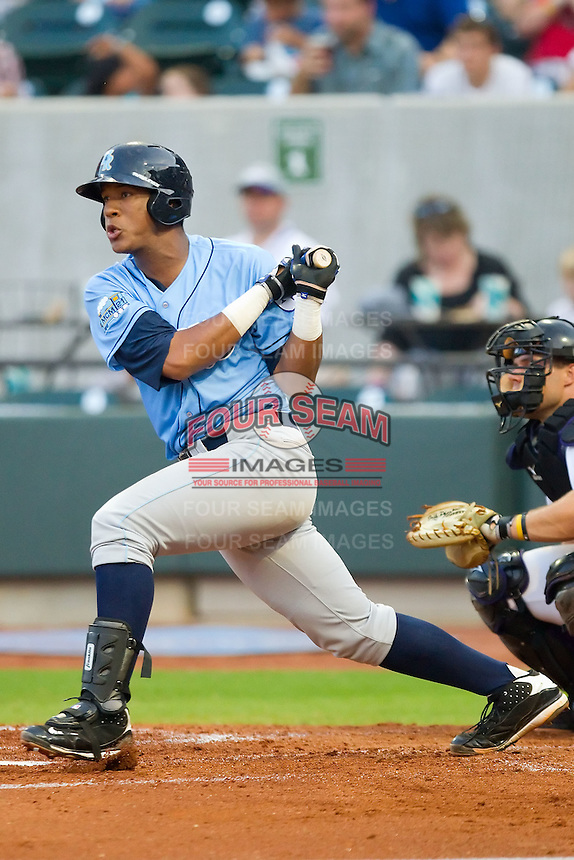Salvador Perez #39 of the Wilmington Blue Rocks follows through on his swing against the Winston-Salem Dash at  BB&T Ballpark August 4, 2010, in Winston-Salem, North Carolina.  Photo by Brian Westerholt / Four Seam Images