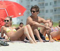 MIAMI  BEACH, FL - MAY 27: Victoria's Secret model Candice Swanepoel celebrates memorial day on Miami Beach. The sexy South African and her Brazilian-born model boyfriend Hermann Nicoli relaxed on the beach and soaked up the sun over Memorial Day Weekend on May 27, 2013 in Miami, Florida.<br /> <br /> <br /> People:  Candice Swanepoel_Hermann Nicoli