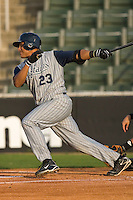Karexon Sanchez #23 of the Lake County Captains follows through on his swing versus the Kannapolis Intimidators at Fieldcrest Cannon Stadium May 1, 2009 in Kannapolis, North Carolina. (Photo by Brian Westerholt / Four Seam Images)
