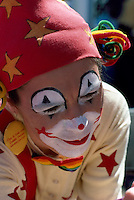 Clown with Painted Face wearing Red Hat (No Model Release Available)