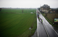 peloton racing over the rainy italian roads<br /> <br /> 106th Milano - San Remo 2015