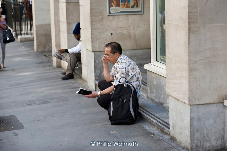 A man using a mobile phone in Covent Garden, London.
