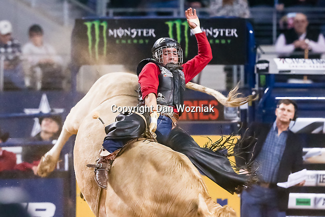 Professional Bull Riders in action during the Choctaw Casino Resort Iron Cowboy VI bull riding event, at the AT & T stadium in Arlington, Texas.