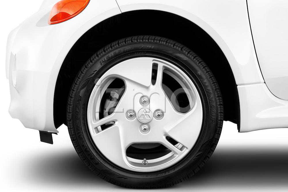Tire and wheel close up detail view of a 2012 Mitsubishi MiEV SE