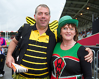 130712 Copyright onEdition 2012 ©.Free for editorial use image, please credit: onEdition..A London Wasps and a London Irish fans enjoying the fun at The Stoop, Twickenham in the first round of The J.P. Morgan Asset Management Premiership Rugby 7s Series...The J.P. Morgan Asset Management Premiership Rugby 7s Series kicked off again for the third season on Friday 13th July at The Stoop, Twickenham with Pool B being played at Edgeley Park, Stockport on Friday, 20th July, Pool C at Kingsholm Gloucester on Thursday, 26th July and the Final being played at The Recreation Ground, Bath on Friday 3rd August. The innovative tournament, which involves all 12 Premiership Rugby clubs, offers a fantastic platform for some of the country's finest young athletes to be exposed to the excitement, pressures and skills required to compete at an elite level...The 12 Premiership Rugby clubs are divided into three groups for the tournament, with the winner and runner up of each regional event going through to the Final. There are six games each evening, with each match consisting of two 7 minute halves with a 2 minute break at half time...For additional images please go to: http://www.w-w-i.com/jp_morgan_premiership_sevens/..For press contacts contact: Beth Begg at brandRapport on D: +44 (0)20 7932 5813 M: +44 (0)7900 88231 E: BBegg@brand-rapport.com..If you require a higher resolution image or you have any other onEdition photographic enquiries, please contact onEdition on 0845 900 2 900 or email info@onEdition.com.This image is copyright the onEdition 2012©..This image has been supplied by onEdition and must be credited onEdition. The author is asserting his full Moral rights in relation to the publication of this image. Rights for onward transmission of any image or file is not granted or implied. Changing or deleting Copyright information is illegal as specified in the Copyright, Design and Patents Act 1988. If you are in any way unsure of your right to publish this image please cont