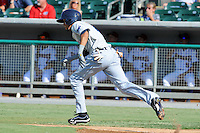 Pensacola Blue Wahoos shortstop Billy Hamilton #4 runs to first during game one of a double header against the  Tennessee Smokies at Smokies Park on July 30, 2012 in Kodak, Tennessee. The Smokies defeated the Blue Wahoos 6-3 in game one and 3-2 in game two. (Tony Farlow/Four Seam Images).