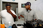 Actor/Comedian Chris Rock listens to Hurricane Katrina evacuee Ronald Williams talk about his escape from New Orleans while Rock on a visit to the Bonita House in Houston,Texas Thursday Sept. 29,2005.