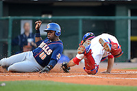 Buffalo Bisons catcher Mike Nickeas #11 tags out a sliding Jason Bourgeois #33 during a game against the Durham Bulls on June 24, 2013 at Coca-Cola Field in Buffalo, New York.  Durham defeated Buffalo 7-1.  (Mike Janes/Four Seam Images)